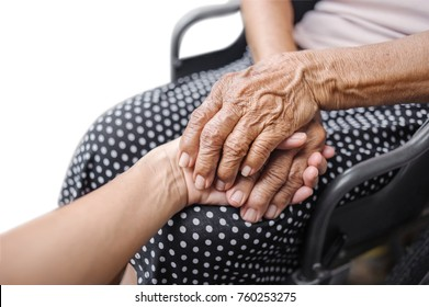 holding hand of young and elderly was sitting in a wheel chair with clipping path