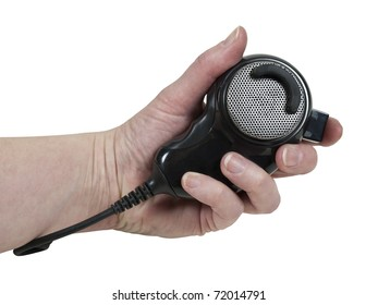 Holding a handheld microphone used to communicate via citizen band radio - path included