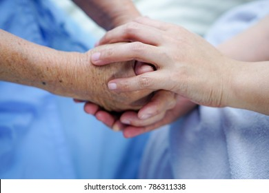 Holding hands Asian senior or elderly old lady woman patient with love, care, encourage and empathy at nursing hospital