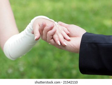 Holding hands of bride and groom outdoor