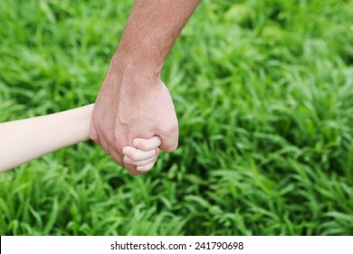 Holding Hands - child and parent