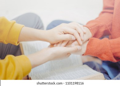 Holding hands encouraged and pray together.Christian mentor concept