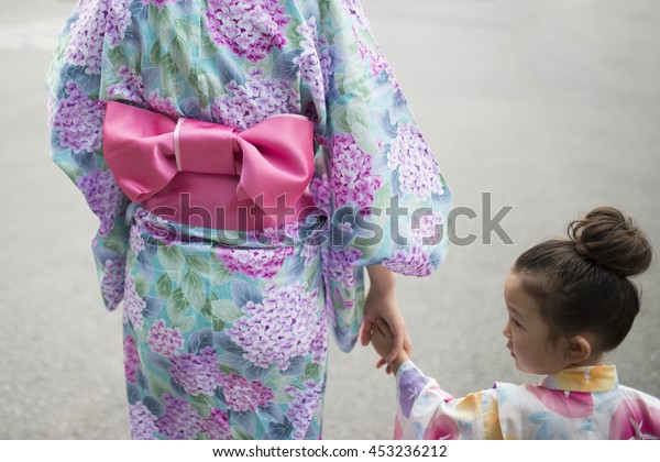 Holding Hands mother and daughter wearing yukata