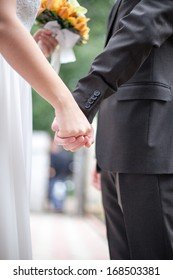 Holding Hands Of newlyweds