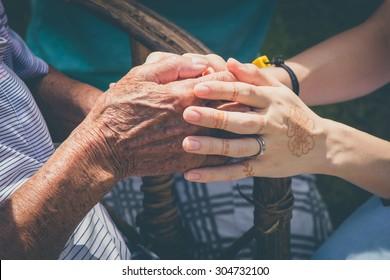 Holding hands. Pray for the elderly.