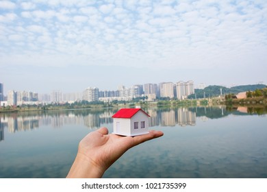 Holding a House Model / Concept River View Room