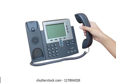 Holding IP phone isolated over white background