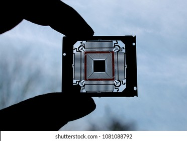 Holding a microprocessor into backlight. Afore, the protective package of the chip was removed.