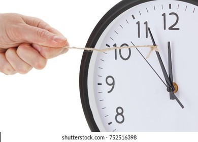 holding minute hand of alarm wall clock, business time management concept