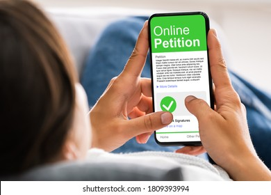 Holding Mobile Phone To Sign Petition. Online Report