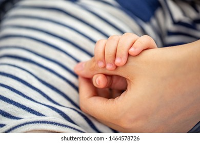 Holding mother hands for her love and protection