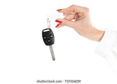 Holding a new car key, isolated on white background