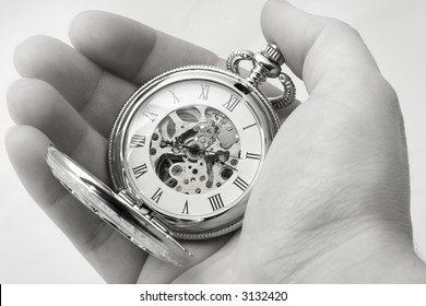 holding old clock, black and white
