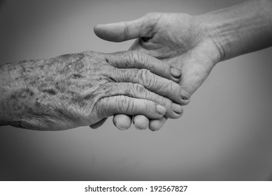 Holding old and young hands