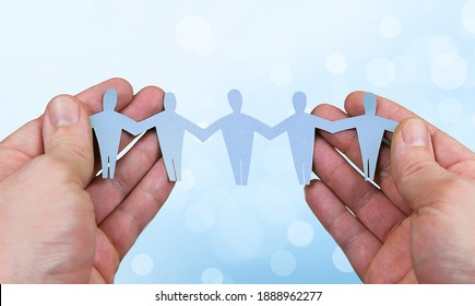 holding paper people team in hands
