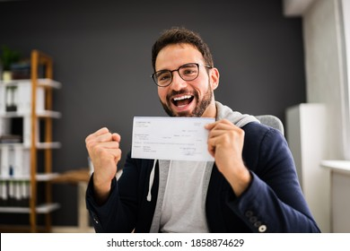 Holding Paycheck Or Payroll Check Or Insurance Cheque In Hand