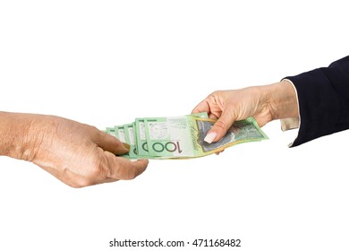 Holding and paying Australian dollar banknotes in white background