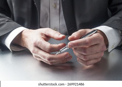 holding a pen for taking notes