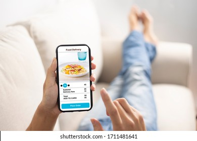 holding phone with application delivery food online
