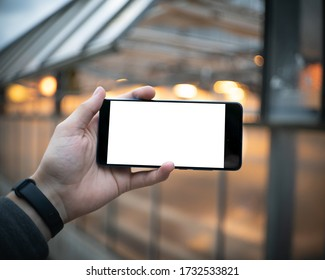 Holding phone in hand with white screen