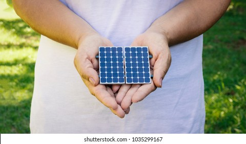 Holding photovoltaic panel in natural background - Concept Image of Sustainable Resources