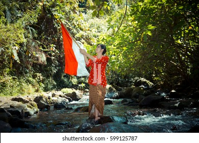 Holding Red-white Flag in the River