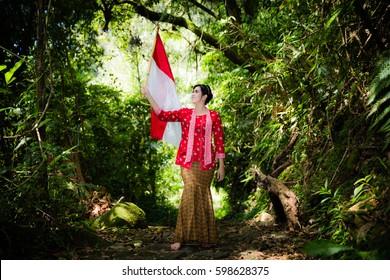 Holding Red-white Flag in the wood