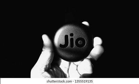 Holding Reliance Jio JioFi - the mobile hotspot - WiFi Hotspot - Black and White [Chennai, TN, India - March 12, 2019]