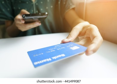 holding smart phone and credit card. Shopping Online