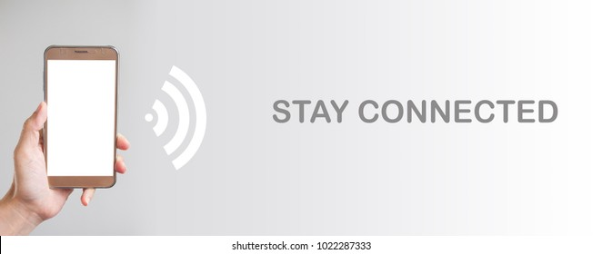 Holding a smartphone with text saying stay connected, banner design for communication and social network concept