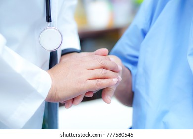 Holding Touching hands Asian senior or elderly old lady woman patient with love, care, encourage and empathy at nursing hospital