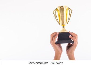 Holding trophy winner hand with white background.