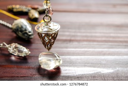 holding and using quartz crystal pendulum and using it In asking questions.