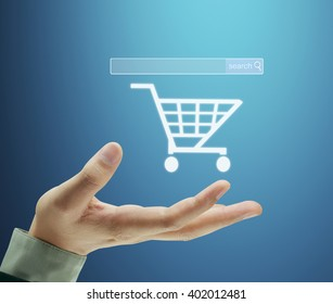 Holding virtual icon of online shopping cart
