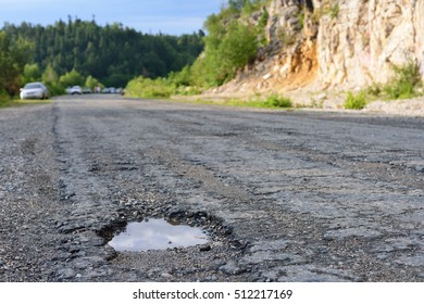 hole in the asphalt, bad road, the risk of movement by car