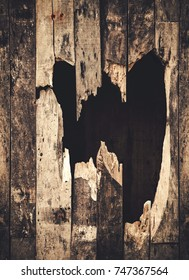 hole of broken grunge wood background