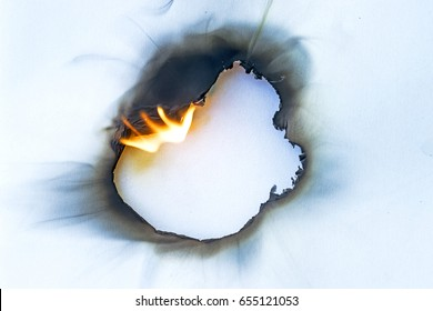 hole burned in paper
