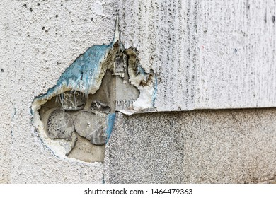 Hole in the concrete wall, Layers of wall insulation, plaster, mesh, foam