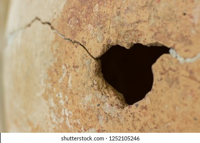hole and crack on ceramic background texture material surface, copy space