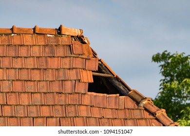 Hole created by missing tiles on a dilapidated old roof