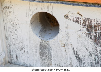 Hole drilled with a diamond drill in the concrete foundation.