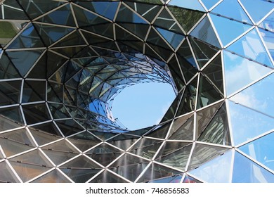 A hole in a glass building.