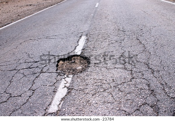 A hole in the middle of the road: time for some civil engineering.