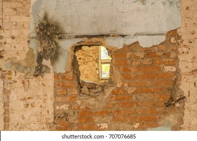 Hole in an old brick house wall