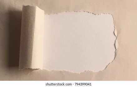 hole in the paper with torn edges.background.