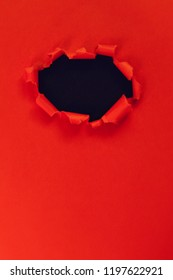 Hole in red paper. frame with a black background for the header. copy space.