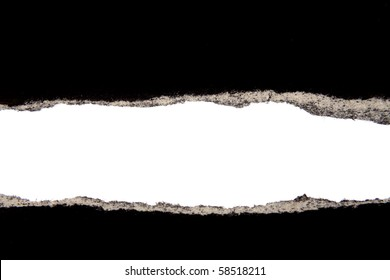 Hole ripped in black paper on white background
