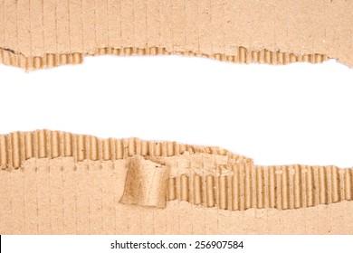 Hole ripped in corrugated cardboard