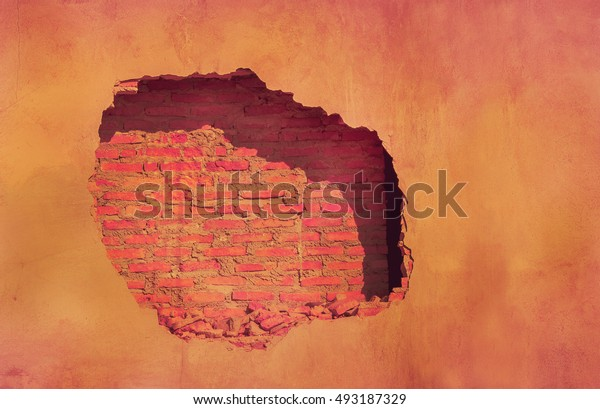hole in wall to brick
