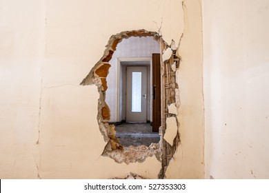 Hole in the wall in a old building destroyed, interior abandoned house